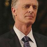 Keith Carradine — Dr. Richard Beckett