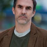 Paul Schneider — Dr. Mike Painter