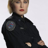 Charlotte Sullivan — Officer Gail Peck