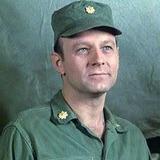 Larry Linville — Major Franklin Delano Marion Burns