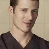 Zach Gilford — Dr. Brett Robinson