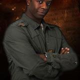 Adrian Lester — Dr. Ben Akomfrah