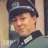 Guy Siner — Lt. Hubert Gruber