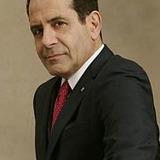 Tony Shalhoub — Senator Raymond
