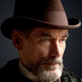Timothy Dalton — Sir Malcolm Murray