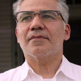 John Ortiz — Reverend Felix Iguero